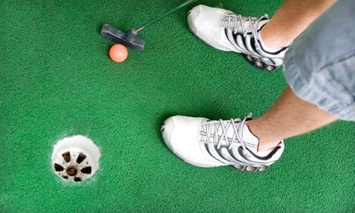 Play Faire Park - Cobb Park Area: $12 for Four Games of Mini Golf and Four Soft Drinks at Play Faire Park