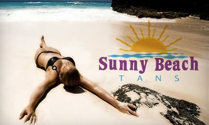 Sunny Beach Tans - Sugar Land: $30 for One Month of Unlimited UV Tanning or Four VersaSpa Spray Tans at Sunny Beach Tans in Sugar Land (Up to $140 Value)
