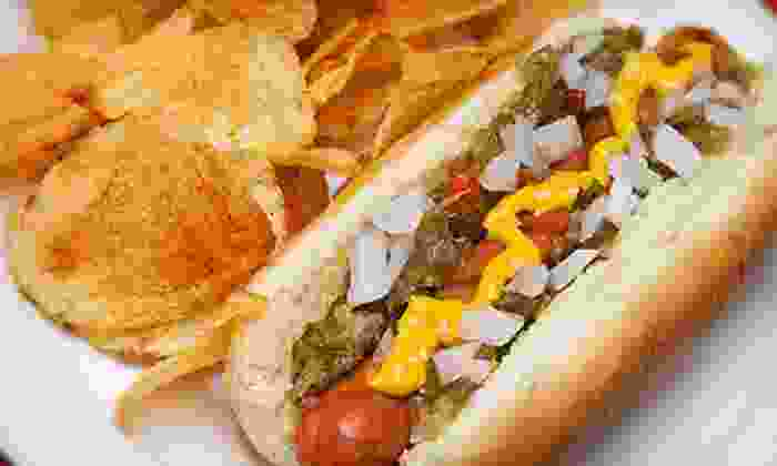 New York Dawg Pound - Overland Park: 10 Premium Dawgs or a Party Package with 25 Dawgs, Toppings, and Sides from New York Dawg Pound (Up to 53% Off)