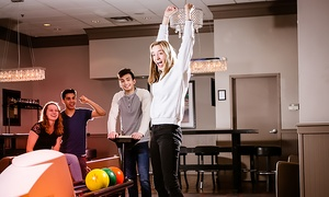 Pinheads: Bowling for Up to 6 with Optional Shoe Rental, or Bowling Suite for Up to 25 at Pinheads (Up to 69% Off)