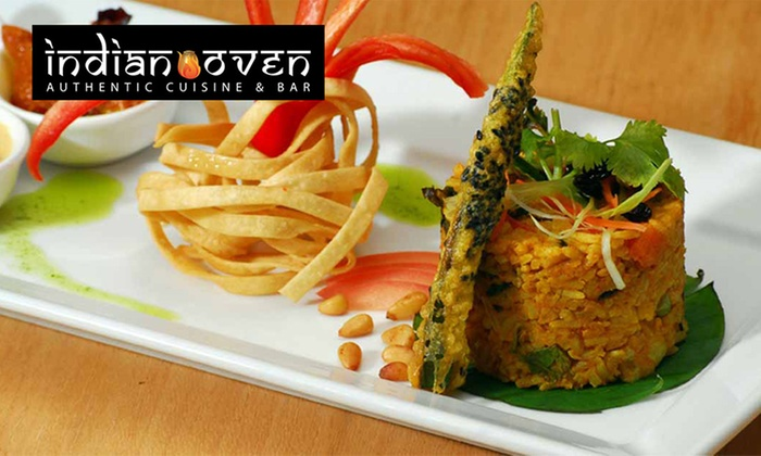 Indian Oven - Tusmore: Three-Course Dinner with Sides and Wine for Two ($29) or Four People ($55) at Indian Oven (Up to $208.40 Value)