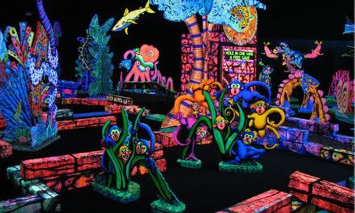 Putting Edge - Howard Hughes Promenade: One Round of Glow-in-the-Dark Mini Golf for Two or Four at Putting Edge (Up to 52% Off)
