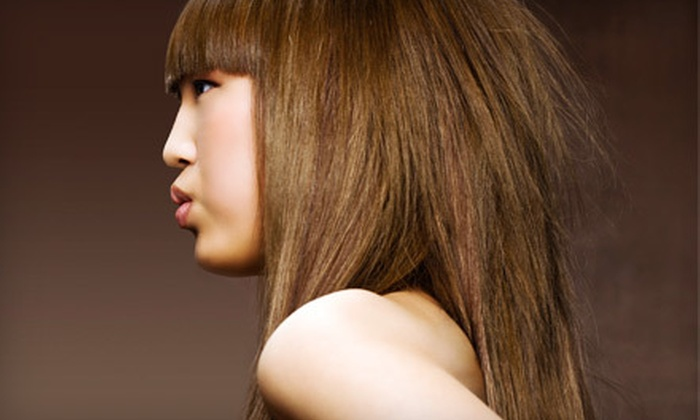 Lady Godiva Hair Studio - Downtown Colorado Springs: Conditioning-Treatment Package with Haircut, or KeraSpa Smoothing Treatment at Lady Godiva Hair Studio (Up to 55% Off)