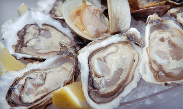 Raw Bar - Lakeview: Two Glasses of Champagne with One Dozen Fresh Oysters or 1.5 Pounds of Maine Lobster at Raw Bar (Up to 53% Off)