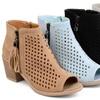 Journee Collection Women's Laser-Cut Tassel Booties