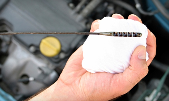 Auto-Lab Complete Car Care Centers - Howell: Oil Change and Tire Rotation at Auto-Lab Complete Car Care Centers in Howell. Two Options Available.