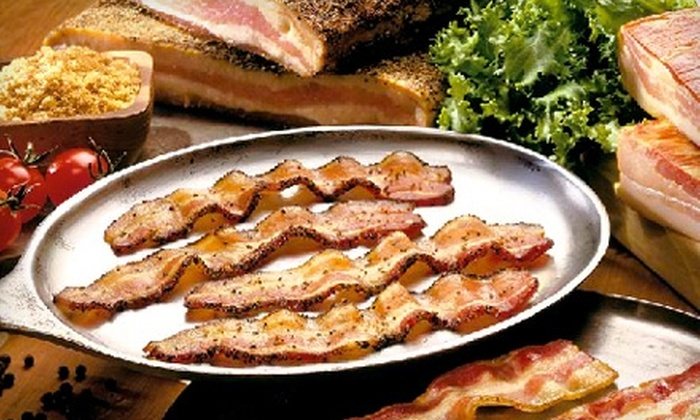 Petit Jean Meats - Morrilton: $35 for 24 oz. of Peppered Bacon, 24 oz. of Hickory-Smoked Bacon, and a Half Bone-In Spiral Ham from Petit Jean Meats ($70 Value)