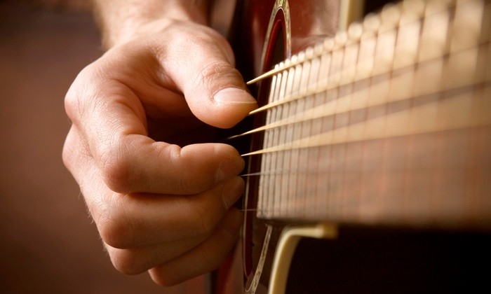 Mercury Guitar Studio - Grand Rapids: 2, 4, or 8 30-Minute Private Guitar Lessons, or 2 Lessons for 2 People at Mercury Guitar Studio (Up to 57% Off)