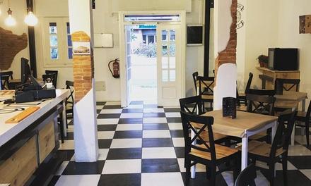 Menú para 2 o 4 personas con entrante, pizza, postre y botella de vino o bebida desde 19,90 € en Pizza Store