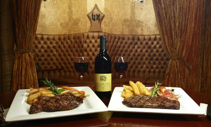Vince Neil's Tatuado Eat Drink Party - The Strip: New York Strip Steak Dinners with Wine & Cheesecake for 2 or 4 at Vince Neil's Tatuado Eat Drink Party (49% Off)