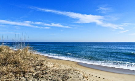 groupon daily deal - Stay at Lighthouse View Oceanfront Lodging in Buxton, NC, with Date into March