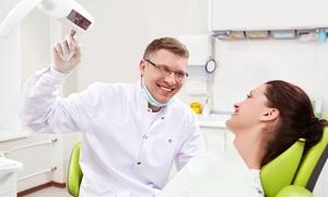 NUOVOCENTRODENTALE: Visita con pulizia, smacchiamento e otturazione per una o 2 persone al Nuovo Centro Dentale (sconto fino a 88%)