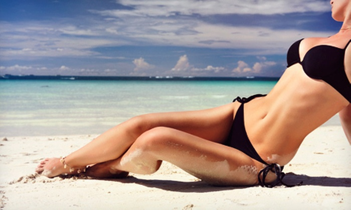Desert Sun Tanning Salons - Multiple Locations: One Month of Unlimited UV Tanning or Three Spray Tans at Desert Sun Tanning Salons (Up to 97% Off). 56 Locations Available.