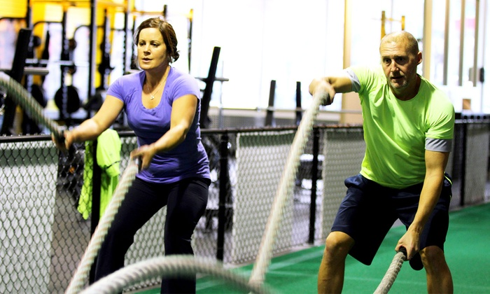 Power Train Sports & Fitness - Ashburn: 1 or 3 Months of Boot Camp or 5 Personal Training Sessions at Power Train Sports & Fitness (Up to 76% Off)