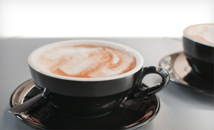 $10 for Four Groupons, Each Good for $5 Worth of Café Drinks and Treats at Coffee Connection ($20 Value)