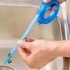 Retractable Drain Relief Tool