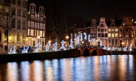 Amsterdam Light Festivalcruise in een luxe salonboot met open bar en kerststol bij Stichting Motorjacht Agatha