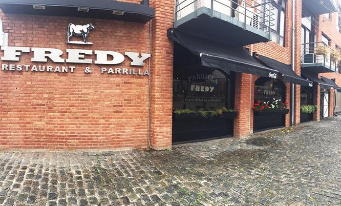 Desde $449 por parrillada + guarnición + copa de espumante para dos o cuatro en Fredy Parrilla Restaurant Puerto Madero