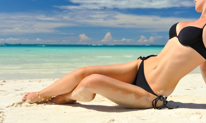 Desert Sun Tanning - Multiple Locations: 30-Consecutive-Days of Unlimited UV Tanning or Three Spray Tans at Desert Sun Tanning Salons (Up to 96% Off)