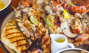 George's Greek Restaurant: Seafood Platter and Glass of Wine from R242 for Two at George's Greek Restaurant (55% Off)
