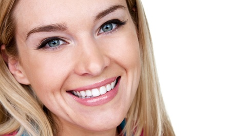 Cleaning, Fluoride, Dental Exam, and X-Rays with Optional Whitening Treatment at Dental 1 (Up to 85% Off)