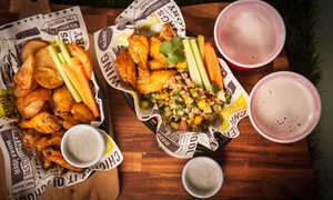 Wings of Glory: 10-Piece Chicken Combo with Pint of Beer for One ($14) or Two ($26) at Wings of Glory, Two Locations (from $24.50 Value)