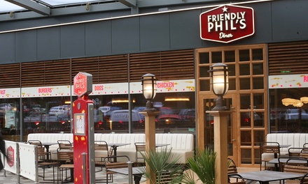 Choice of Burger or Hot Dog with Side and Soft Drink for Up to Four at Friendly Phil's, Two Locations