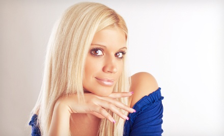 Haircut Package with Optional Color or Partial or Full Highlights from John Ira at The Corner Salon (Up to 67% Off)