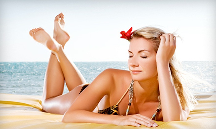 Aztec Tan - Rolando: Five Mystic Tan Spray Tans, 10 Level 4 Tanning-Bed Sessions, or Three Airbrush Tans at Aztec Tan (Up to 73% Off)
