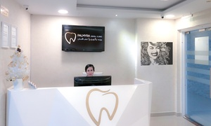 Palmyra Dental Clinic DMCC: Consultation, Scale and Polish with Cleaning, Stain Removal or Periapical X-Ray and Whitening at Palmyra Dental Clinic