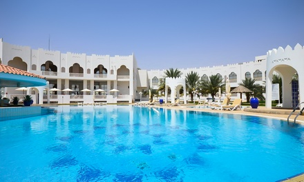 Al Gharbia: 1 or 2 Nights for Two Adults and Two Children with Option for Breakfast or Half  or Full Board at Liwa Hotel