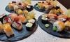 Sushi y botella de vino