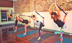 OM Power Yoga: One-Month Unlimited Yoga Classes for One ($19) or Two People ($35) at OM Power Yoga (Up to $358 Value)