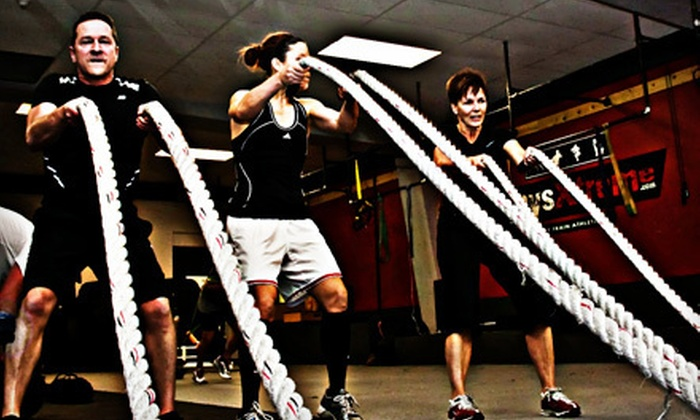 PhysXtreme - District Saint - Raymond - Vanier: 8 or 16 Boot-Camp or Kettlebell Classes at PhysXtreme (82% Off)