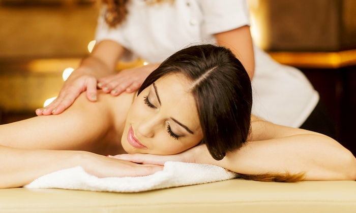 Blue Monarch Massage - Garden Ridge: 60-Minute Aromatherapy Massage Package with Back & Foot Scrub & $25 Gift Card at Blue Monarch Massage (52% Off)