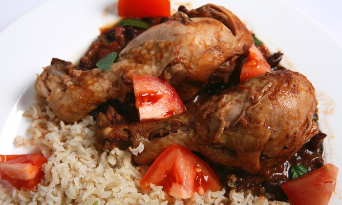 Dominican Grill - Powder Springs: 65% Off 1 Natural Juice with Purchase of Chicken Stew Entree at Dominican Grill