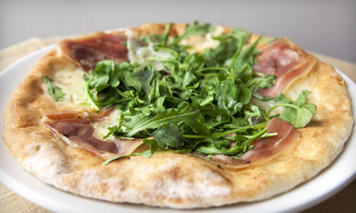 Penguin Pizza - Mission Hill: Dine-In Pizza, Pasta, and Paninis at Penguin Pizza (48% Off). Two Options Available.
