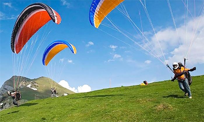 Gleitschirmschule Tegernsee - Gleitschirmschule Tegernsee: Kompletter5 tägiger Paragliding-Grundkurs mit Leihausrüstung bei der Gleitschirmschule Tegernsee (bis zu 36% sparen*).