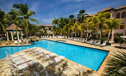 groupon daily deal - 3-, 4-, or 5-Night Stay for Two in a Studio or One-Bedroom Suite at Caribbean Palm Village Resort Aruba