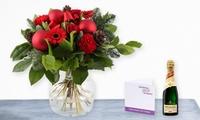 Weihnachtlicher Blumenstrauß mit persönlicher Grußkarte und Piccolo von Floriënt Express (46% sparen*)