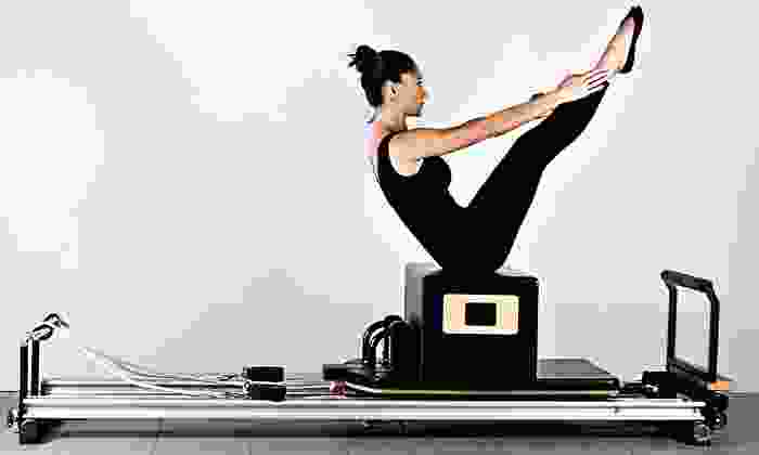 BodyKind Pilates - West Downtown: 4 or 10 Group Reformer Pilates Classes with One Private Reformer Session at BodyKind Pilates (Up to 69% Off)