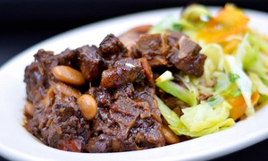 The Paradigm: Jamaican Cuisine for Two or Four at The Paradigm (Up to 47% Off)