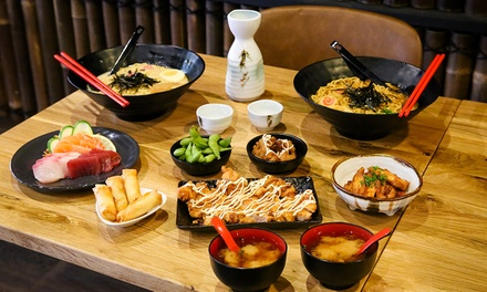 Japanese Banquet with Sake for Two ($44) or Four People ($88) at Sushi Arigato (Up to $143 Value)