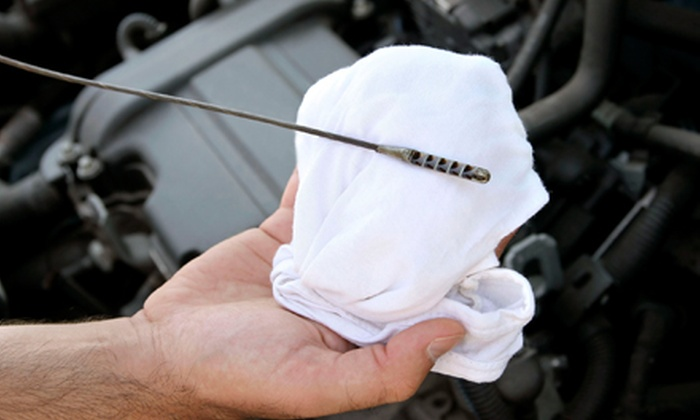 Alper Automotive, Inc. - Holmesburg: One or Three Oil-Change Packages with Tire Rotations and Pair of Wiper Blades at Alper Automotive, Inc. (Up to 77% Off)