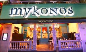 Mykonos: Desde $749 por cena gourmet griega para dos o cuatro + botella de vino y show en Mykonos