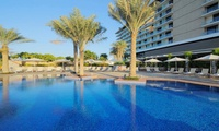Pool Access with Optional Food Credit for Up to Four at Health & Fitness at Radisson Blu (Up to 55% Off)
