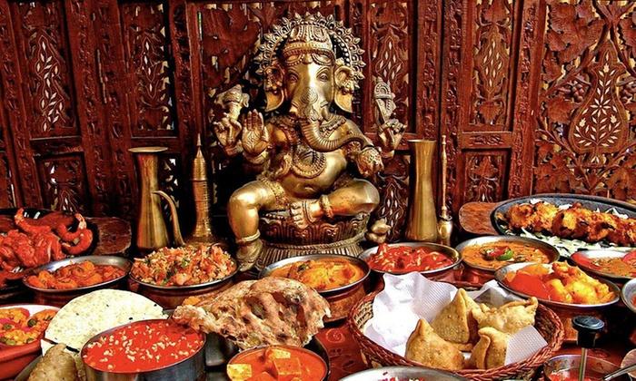 Menu indiano di carne, vegetariano o vegano con birra al Pooja Indian Restaurant (sconto fino a 54%)