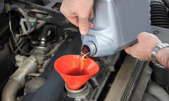 Oil Change or Alignment with Tire Rotation and Inspection at Midas (Up to 47% Off). Eight Options Available.