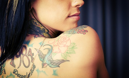 Tattoo, Piercing, or Body Jewelry at Dilligaf Tanning, Tattoo, & Piercing (Up to 60% Off). Five Options Available.