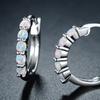 White Fire Opal Hoop Earrings in Rhodium Plating by Peermont